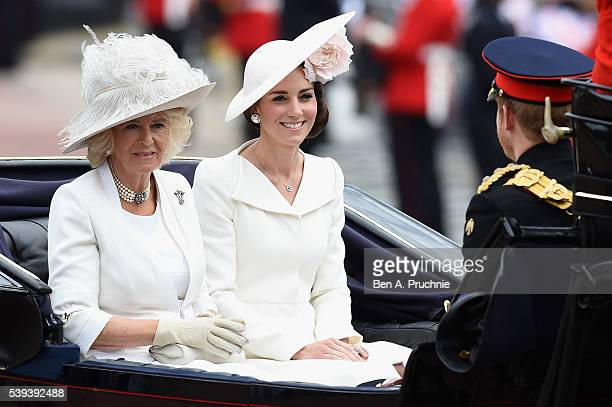 Camilla, Duchess of Cornwall and Catherine, Duchess of Cambridge sit in a carriage during the Trooping the Colour, this year marking the Queen's 90th...