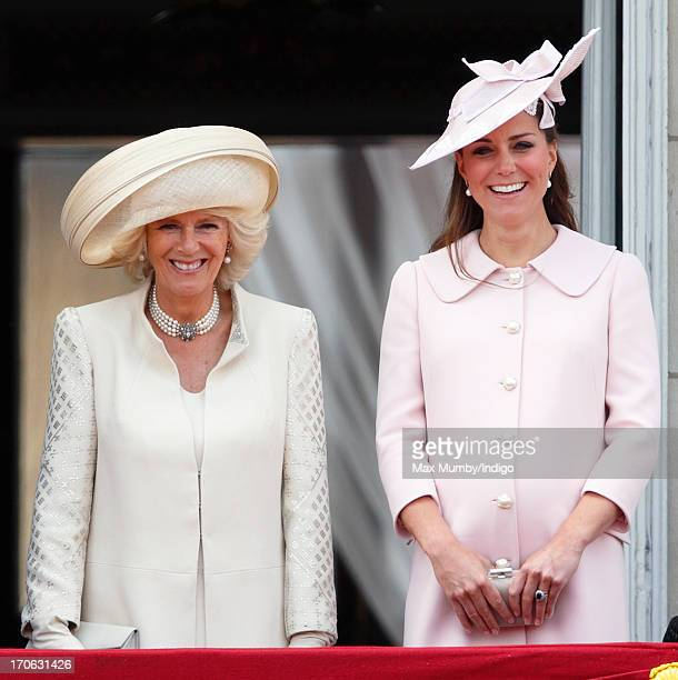 Camilla Duchess of Cornwall and Catherine Duchess of Cambridge stand on the balcony of Buckingham Palace during the annual Trooping the Colour...