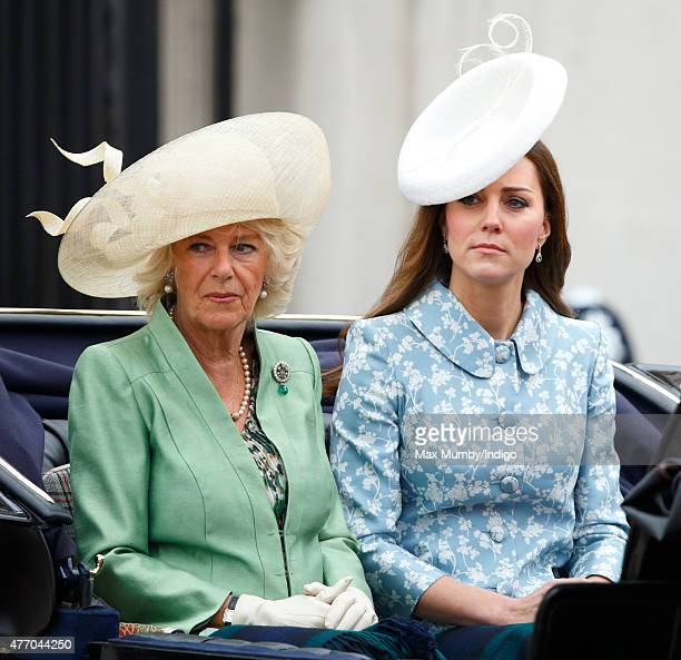 Camilla Duchess of Cornwall and Catherine Duchess of Cambridge travel down The Mall in a horse drawn carriage during Trooping the Colour on June 13...