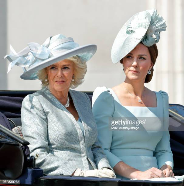 Camilla Duchess of Cornwall and Catherine Duchess of Cambridge travel down The Mall in a horse drawn carriage during Trooping The Colour 2018 on June...