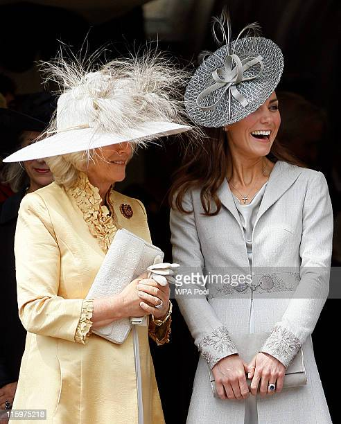 Camilla, Duchess of Cornwall and Catherine, Duchess of Cambridge watch the Garter Service pass by on June 13, 2011 in Windsor, England. The Order of...