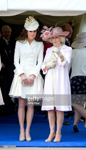 Camilla Duchess of Cornwall and Catherine Duchess of Cambridge watch the Order of the Garter procession at Windsor Castle on June 18 2011 in Windsor...