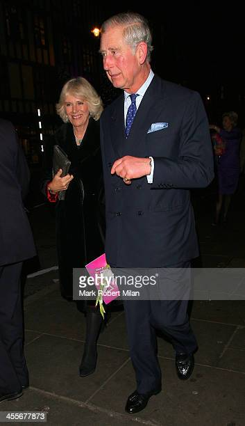 Camilla Duchess of Cornwall and Charles Prince of Wales leaving the Palladium theatre on December 12 2013 in London England