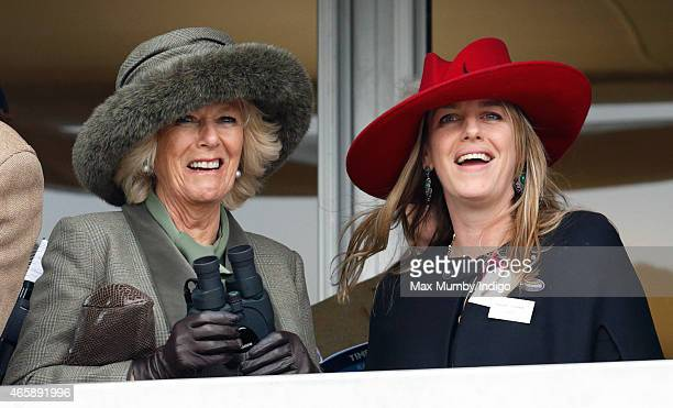 Camilla Duchess of Cornwall and daughter Laura Lopes watch the racing as they attend day 2 of the Cheltenham Festival at Cheltenham Racecourse on...