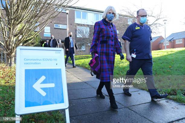 Camilla, Duchess of Cornwall and Director of quality and chief nurse, Professor Steve Hams during a visit to Gloucestershire Vaccination Centre at...