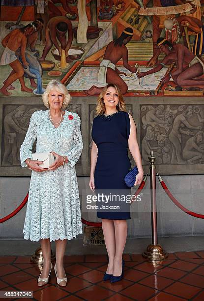 Camilla Duchess of Cornwall and First Lady of Mexico Anjelica Rivera walk under murals by Diego Rivera at the National Palace on November 3 2014 in...