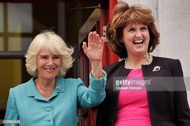 Camilla Duchess of Cornwall and Irish Tanaiste Joan Burton are seen during their visit to Claddagh Primary School to meet children on May 19 2015 in...