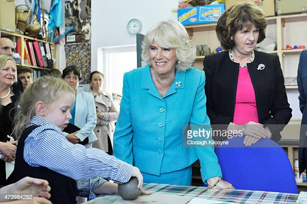 Camilla Duchess of Cornwall and Irish Tanaiste Joan Burton are seen during their visit to Claddagh Primary School to meet children in an arts and...