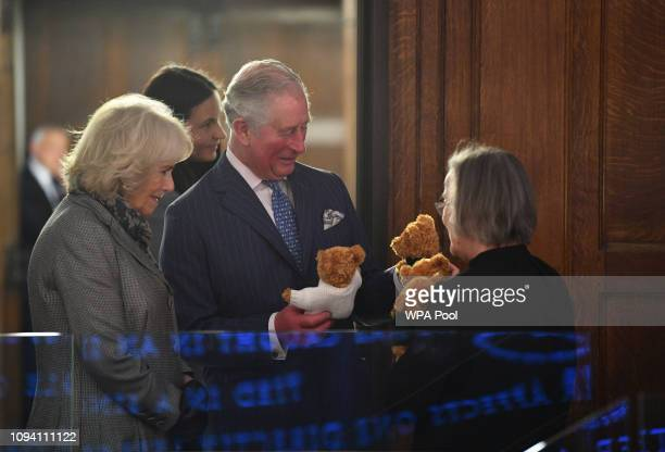 Camilla, Duchess of Cornwall and Prince Charles, Prince of Wales are presented with toys by Lady Hale, President of the Supreme Court during a visit...