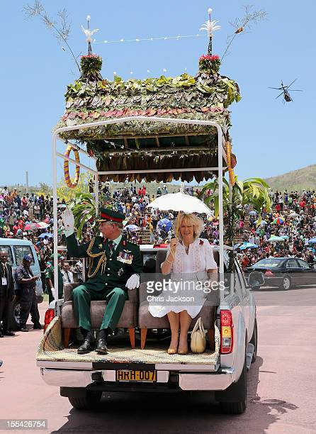 Camilla Duchess of Cornwall and Prince Charles Prince of Wales are driven around Sir John Guise Stadium after a cultural event on November 4 2012 in...