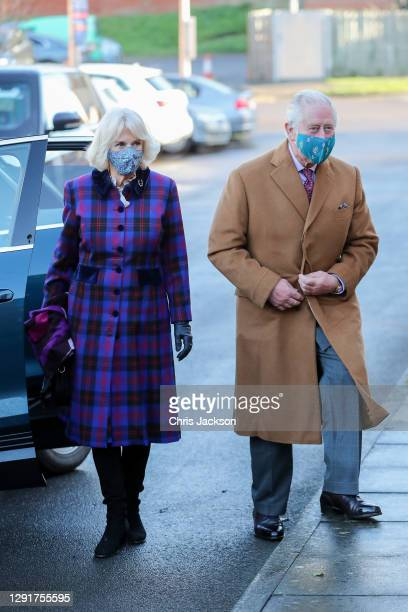 Camilla, Duchess of Cornwall and Prince Charles, Prince of Wales arrive at Gloucestershire Vaccination Centre at Gloucestershire Royal Hospital on...