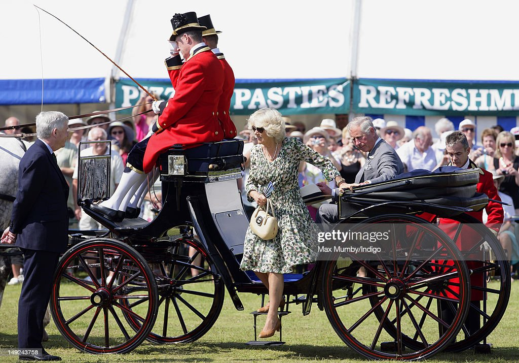 Camilla, Duchess of Cornwall and Prince Charles, Prince of Wales arrive by horse drawn carriage to tour the Sandringham Flower Show at Sandringham on July 25, 2012 in King's Lynn, England.