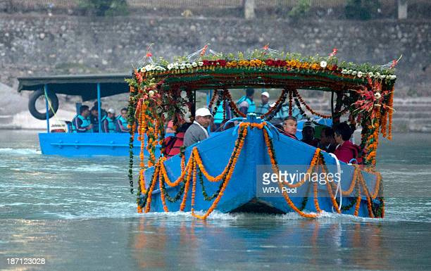 Camilla Duchess of Cornwall and Prince Charles Prince of Wales arrive to take part in an Aarti ceremony at the Parmarth Niketan Temple on the banks...