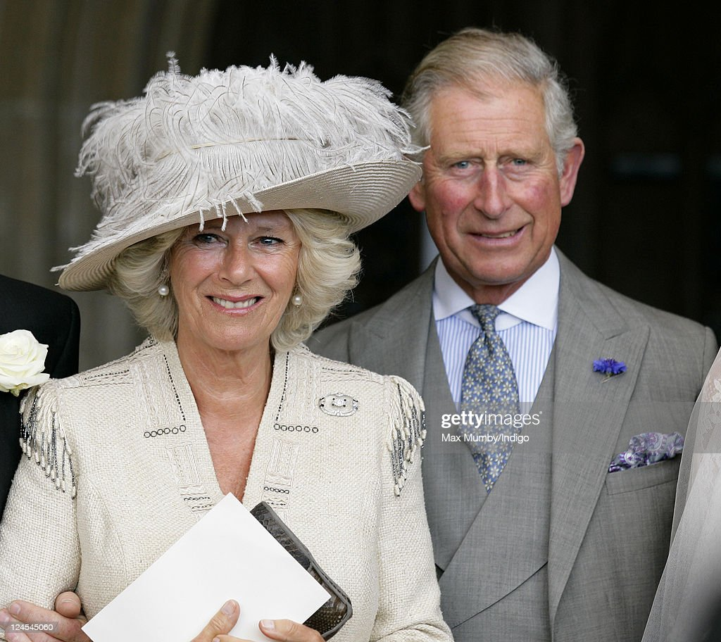 Camilla, Duchess of Cornwall and Prince Charles, Prince of Wales attend the wedding of Ben Elliot and Mary-Clare Winwood at the church of St. Peter and St. Paul, Northleach on September 10, 2011 in Cheltenham, England.