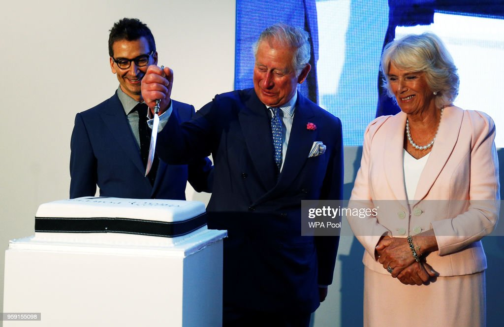 Camilla, Duchess of Cornwall and Prince Charles, Prince of Wales cut a cake with Chief Executive of Yoox Net-a-Porter Group Federico Marchetti they tour the new Tech Hub at the Yoox Net-a-Porter Group offices on May 16, 2018 in London England.