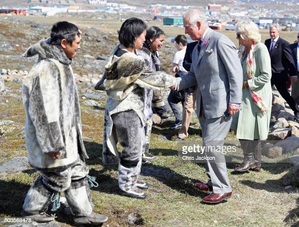 Camilla, Duchess of Cornwall and Prince Charles, Prince of Wales during a community feast event at Sylvia Grinnel Territorial Park during a 3 day...