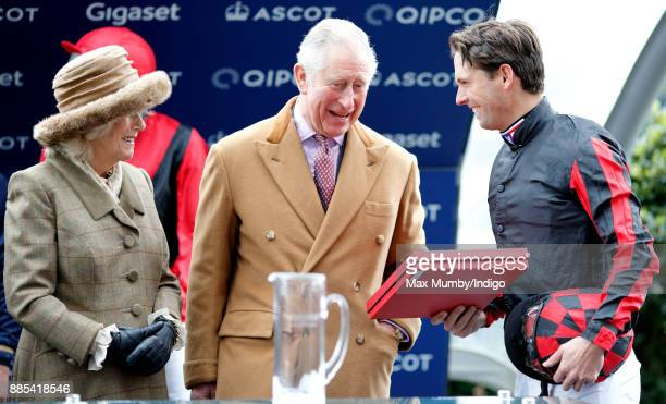 Camilla Duchess of Cornwall and Prince Charles Prince of Wales present Harry Meade with his prize for taking part in the The Prince's Countryside...