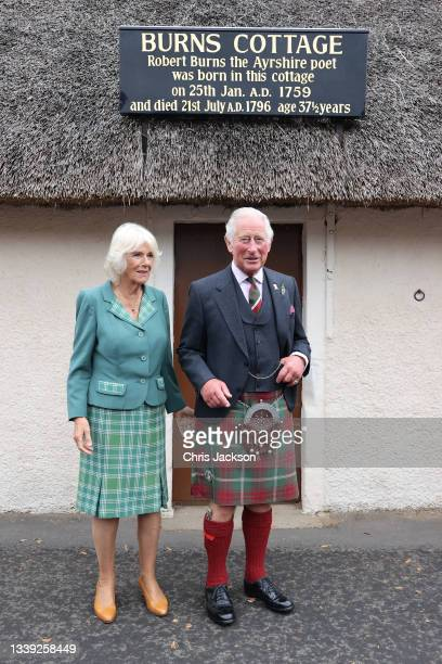Camilla, Duchess of Cornwall, and Prince Charles, Prince of Wales known as the Duke and Duchess of Rothesay when in Scotland pose in front of Robert...