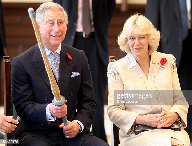 Camilla Duchess of Cornwall and Prince Charles Prince of Wales laugh after the Prince was given a bamboo sword by a Kendo fighter during a visit to...