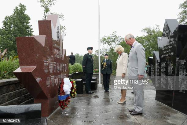 Camilla Duchess of Cornwall and Prince Charles Prince of Wales lay a wreath at the Afghanistan Repatriation Memorial during a 3 day official visit to...