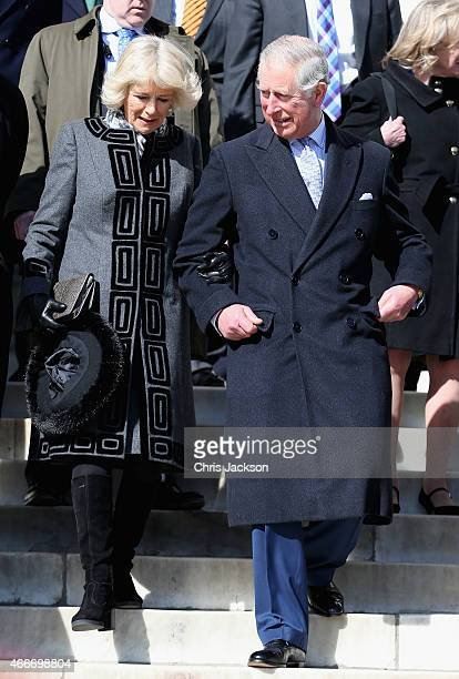 Camilla Duchess of Cornwall and Prince Charles Prince of Wales link arms as they walk down the steps of the Lincoln Memorial on the second day of a...