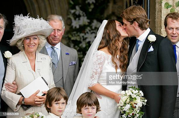 Camilla Duchess of Cornwall and Prince Charles Prince of Wales look on as MaryClare Winwood and Ben Elliot kiss after their wedding at the church of...