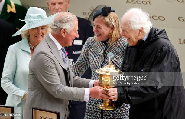 Camilla, Duchess of Cornwall and Prince Charles, Prince of Wales present Lynn Forester de Rothschild and Sir Evelyn de Rothschild with the trophy...