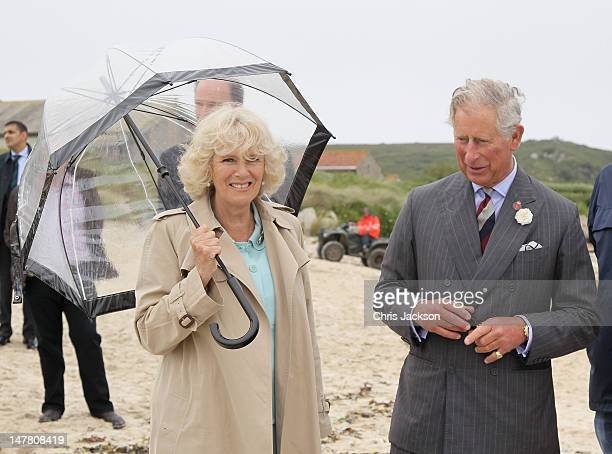 Camilla Duchess of Cornwall and Prince Charles Prince of Wales meet gig crews from the Tresco and Bryher team on Bryher Island on the Scilly Isles on...