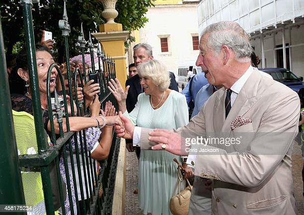 Camilla Duchess of Cornwall and Prince Charles Prince of Wales meet members of the public during a visit to the Museo del Oro Zenu on October 31 2014...