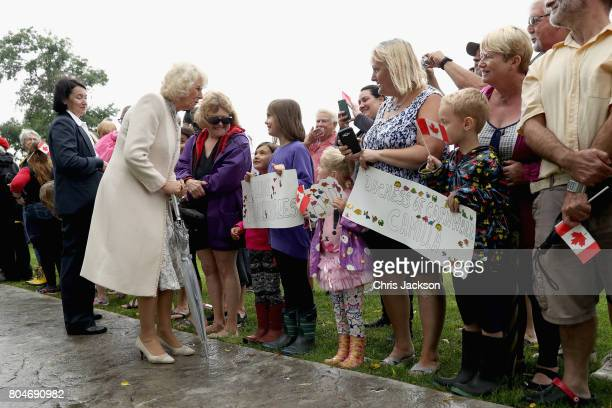Camilla Duchess of Cornwall and Prince Charles Prince of Wales meet members of the public at the Afghanistan Repatriation Memorial during a 3 day...