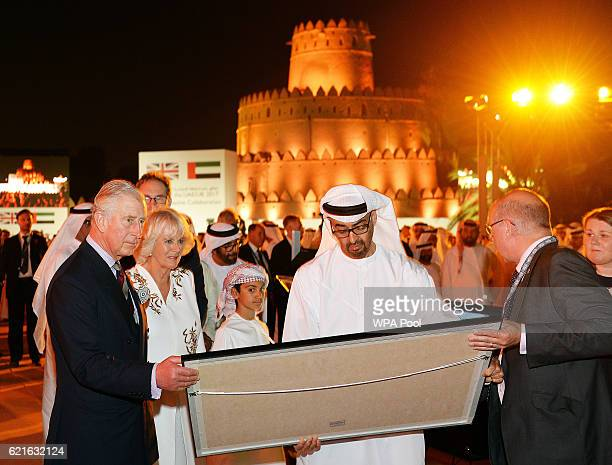 Camilla Duchess of Cornwall and Prince Charles Prince of Wales present facsimiles of a Koran manuscript held by the University of Birmingham one of...
