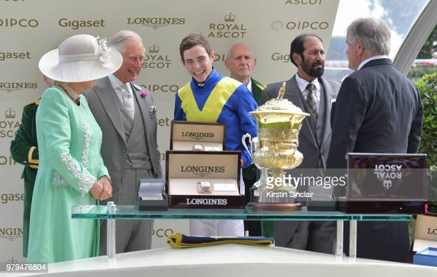 Camilla Duchess of Cornwall and Prince Charles Prince of Wales present jockey James Doyle owner Saeed Suhail and trainer Sir Michael Stoute with the...
