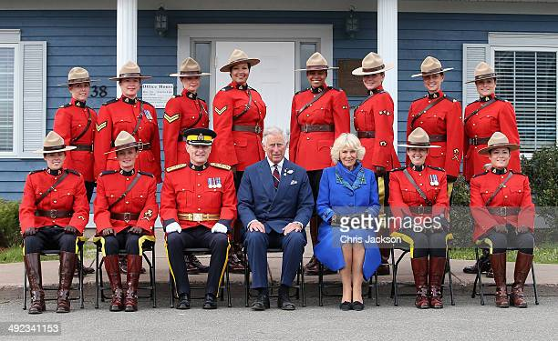 Camilla Duchess of Cornwall and Prince Charles Prince of Wales pose for a photograph with the Royal Canadian Mounted Police on May 19 2014 in Pictou...