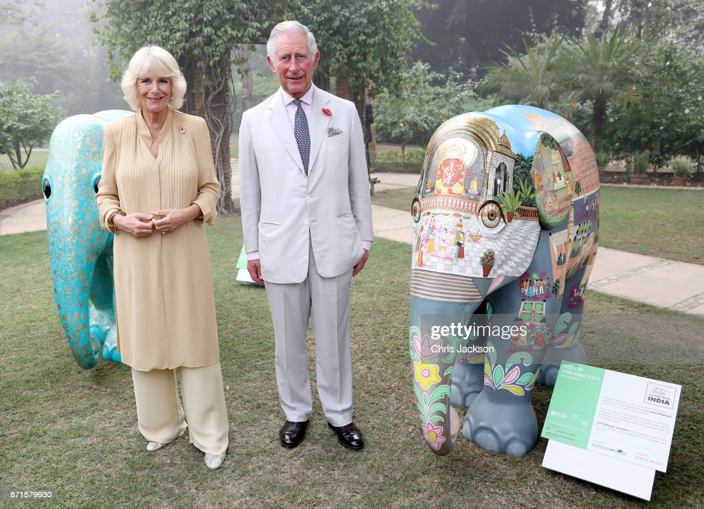 Camilla, Duchess of Cornwall and Prince Charles, Prince of Wales pose with two of the 101 painted sculptures, named after the 101 elephant corridors that have been mapped across the country, at an 'Elephant Parade' during the Elephant Family charity event held at the British High Commissioner's Residence on November 8, 2017 in New Delhi, India. The Prince of Wales and Duchess of Cornwall are on a tour of Singapore, Malaysia, Brunei and India.
