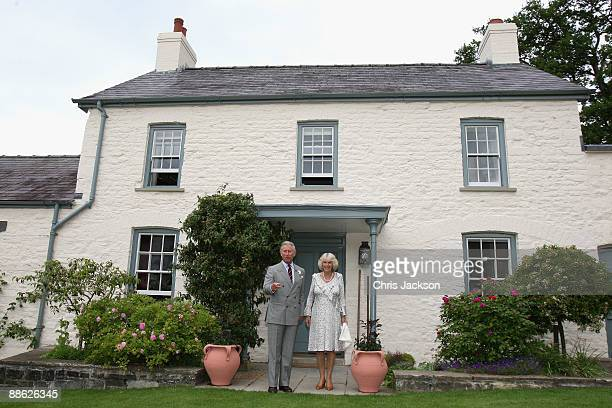 Camilla Duchess of Cornwall and Prince Charles Prince of Wales pose for a photograph outside their welsh property Llwynywermod before a drinks...