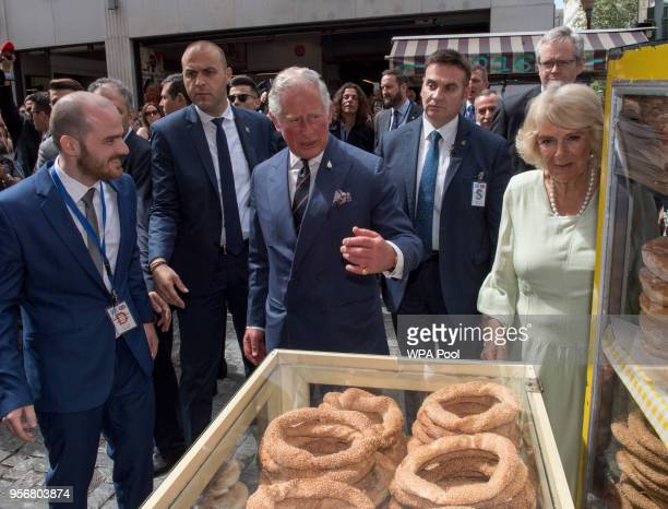 Camilla Duchess of Cornwall and Prince Charles Prince of Wales sample koulouri they take a brief walking tour of the Kapnikarea Area of central...