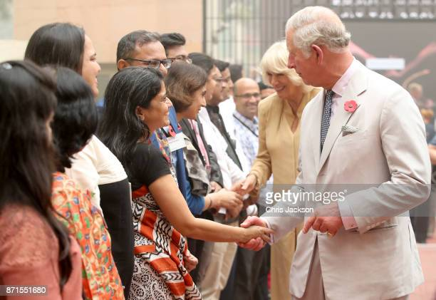 Camilla Duchess of Cornwall and Prince Charles Prince of Wales shake hands as they attend a celebration of the UKIndia Year of Culture hosted at the...