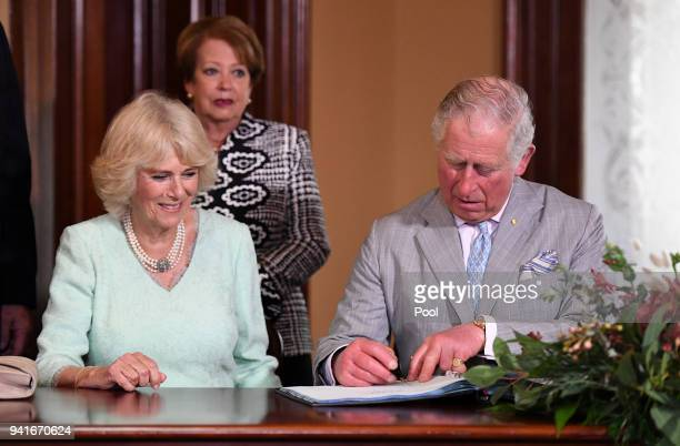 Camilla Duchess of Cornwall and Prince Charles Prince of Wales sign the guest book at the Old Government House on April 4 2018 in Brisbane Australia...