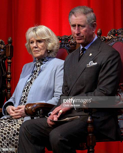 Camilla, Duchess of Cornwall and Prince Charles, Prince of Wales sit on stage at Stoke-on-Trent Town Hall during on February 19, 2010 in Stoke on...