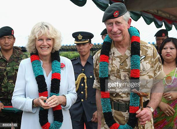 Camilla Duchess of Cornwall and Prince Charles Prince of Wales smile after being given garlands at the British Garrison on October 31 2008 in Brunei...
