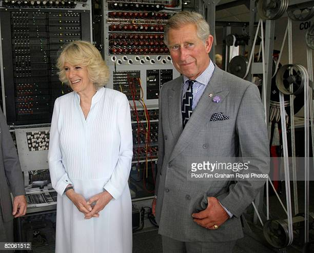 Camilla Duchess of Cornwall and Prince Charles Prince of Wales stand beside a rebuilt 'Colossus' machine during a visit to Bletchley Park National...