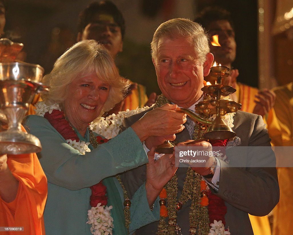 Camilla, Duchess of Cornwall and Prince Charles, Prince of Wales take part in an Aarti ceremony at the Parmarth Niketan Temple on the banks of the River Ganges during day 1 of an official visit to India on November 6, 2013 in Dehradun, India. This will be the Royal couple's third official visit to India together and their most extensive yet, which will see them spending nine days in India and afterwards visiting Sri Lanka in order to attend the 2013 Commonwealth Heads of Government Meeting.