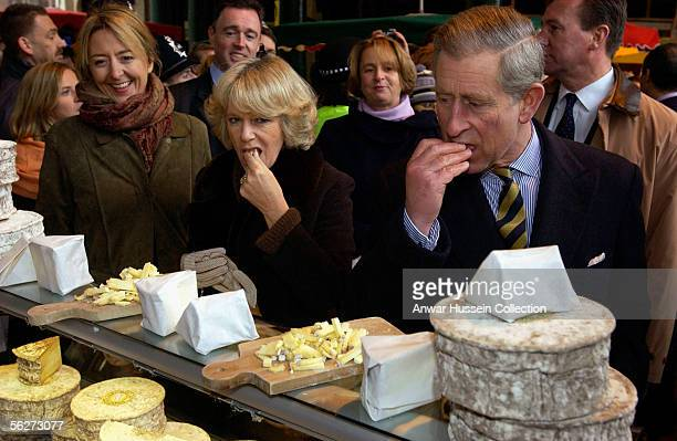 Camilla, Duchess Of Cornwall and Prince Charles, Prince of Wales taste cheese when they visit Borough Market on November 25, 2005 in London, England.