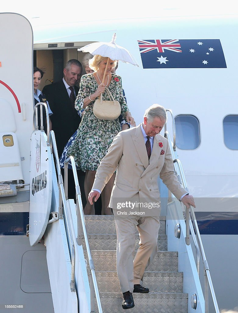 Camilla, Duchess of Cornwall and Prince Charles, Prince of Wales disembark the royal plane on November 5, 2012 in Longreach, Australia. The Royal couple are in Australia on the second leg of a Diamond Jubilee Tour taking in Papua New Guinea, Australia and New Zealand.