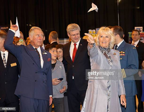 Camilla, Duchess of Cornwall and Prince Charles, Prince of Wales throw paper aeroplanes with the Prime Minister of Canada Stephen Harper at Stevenson...