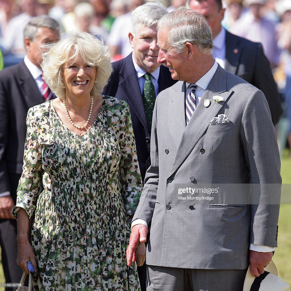 Camilla, Duchess of Cornwall and Prince Charles, Prince of Wales tour the Sandringham Flower Show at Sandringham on July 25, 2012 in King's Lynn, England.