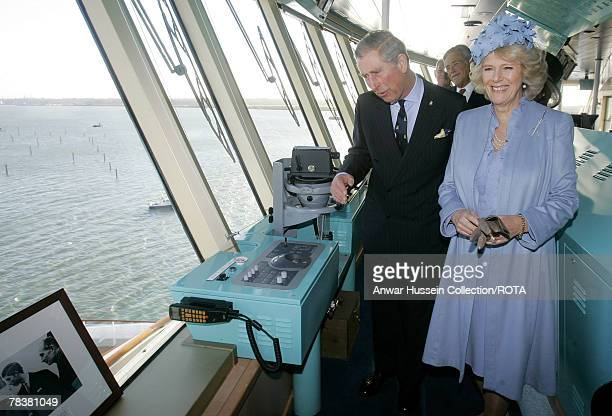 DAYS*** Camilla Duchess of Cornwall and Prince Charles Prince of Wales tour the ship's bridge during a visit to the Cunard Liner Queen Victoria which...