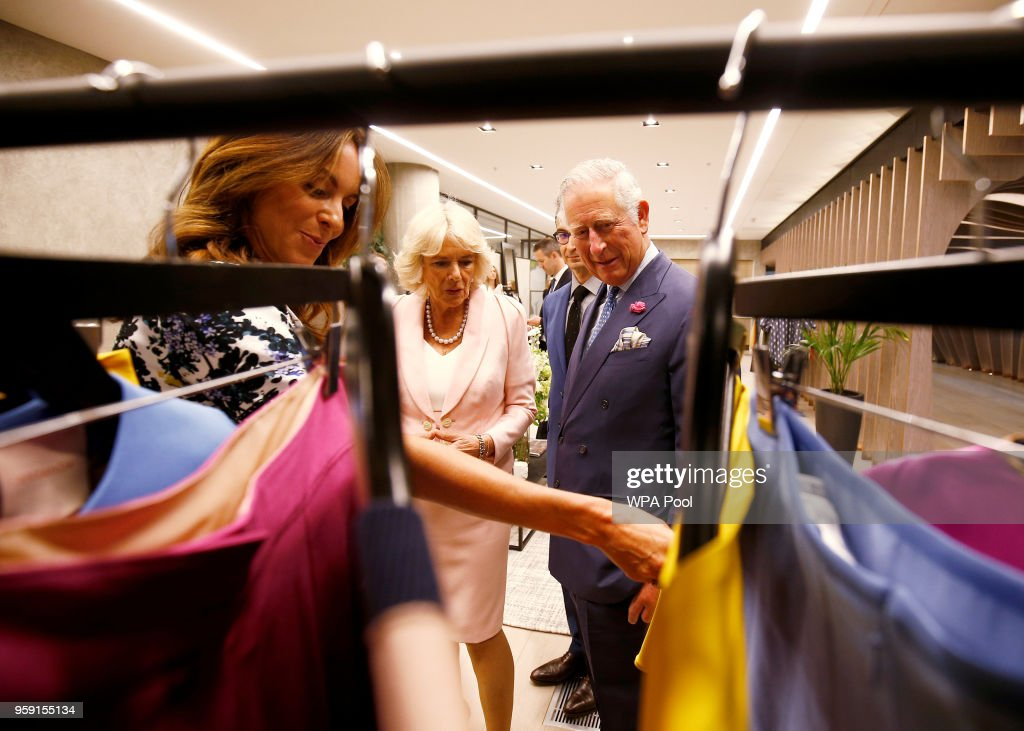 Camilla, Duchess of Cornwall and Prince Charles, Prince of Wales tour the new Tech Hub, with British Fashion Council Chief Executive Caroline Rush, at the Yoox Net-a-Porter Group offices on May 16, 2018 in London England.