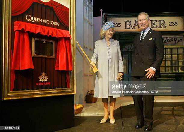 DAYS*** Camilla Duchess of Cornwall and Prince Charles Prince of Wales unveil a plaque on stage during a visit to the Cunard Liner Queen Victoria...