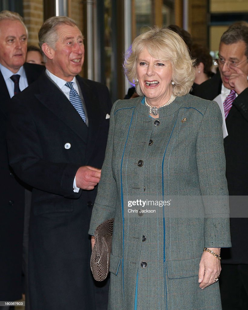 Camilla, Duchess of Cornwall and Prince Charles, Prince of Wales visit platform 9 3/4 at King's Cross Rail Station during a visit to mark 150 years of London Underground on January 30, 2013 in London, England.